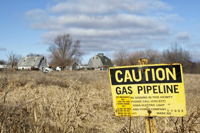 image of barns and pipeline sign