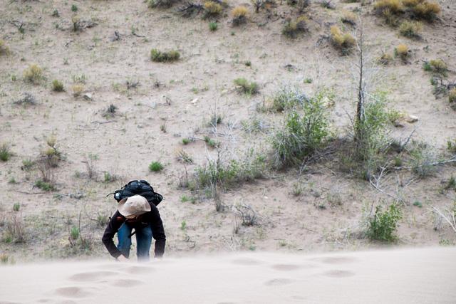 Danielle climbs up a dune